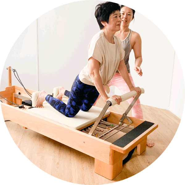 An image of the reformer - the main piece of pilates equipment in any studio.